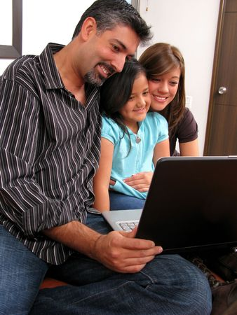 Family to meet in the room look at computer