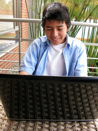 Portrait of a young using laptop outdoors Stock Photo - 6996158