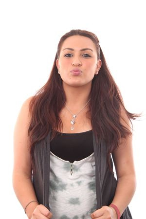 Portrait of a beautiful young woman seding a kiss photo