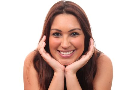 Closeup portrait of happy young woman with hands in the face photo