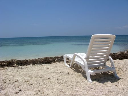 Beautiful scene at the beach with chair photo