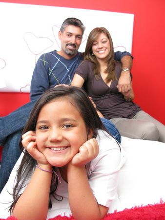 Family reclining in bed smiling at camera Stock Photo - 7266059