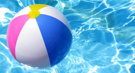 blue ball: Multi colored Beach ball in swimming pool