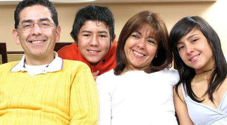 look latino: Beauty family sitting in living room smiling