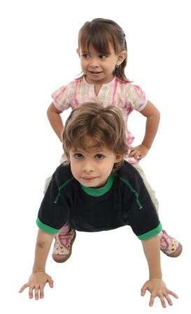 giving back: Happy children playing together and giving a piggy back ride.