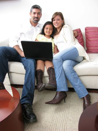 Parents whit son look in notebook on white background Stock Photo - 7338916