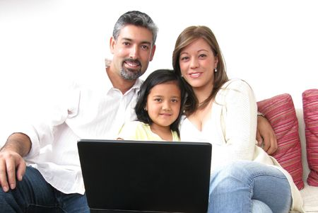 Parents whit son look in notebook on white background Stock Photo - 7413878