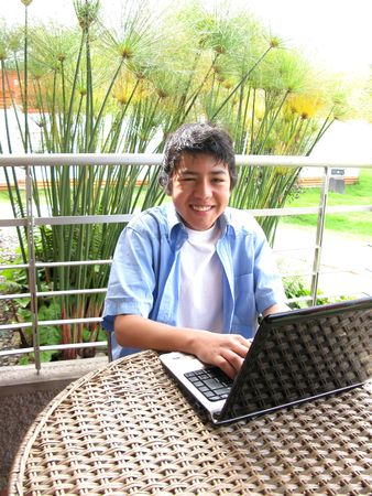 Portrait of a young using laptop outdoors Stock Photo - 7433046