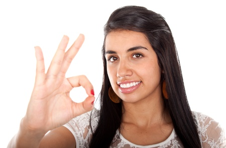 bonny: Beautiful smiling model with OK gesture over white  Stock Photo