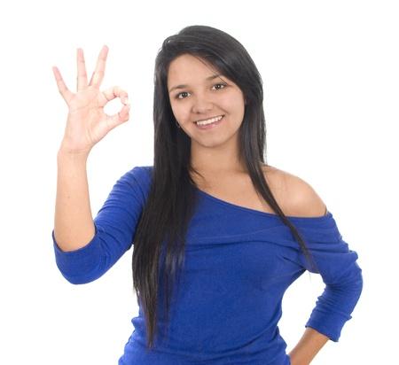 Beautiful young lady indicating ok sign, isolated on white. Stock Photo - 10950112