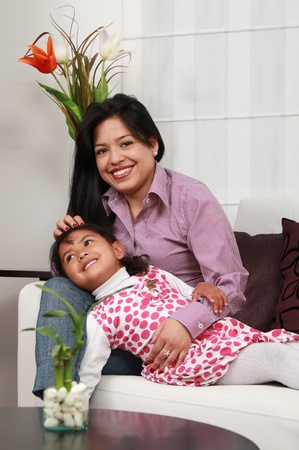 mother and girl smiling in the living room white photo