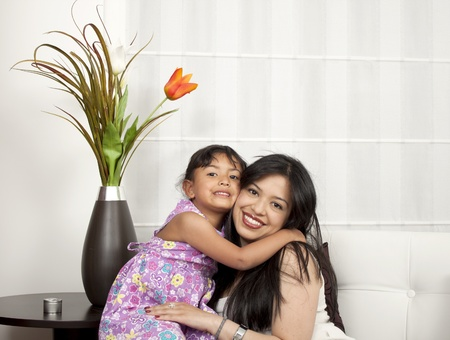mother and girl smiling in the living room Stock Photo - 13259846