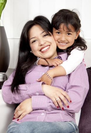A young happy woman hugs an child girl happy Stock Photo - 13905529