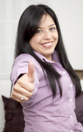 Portrait of a happy woman showing thumbs up  Stock Photo - 13905522