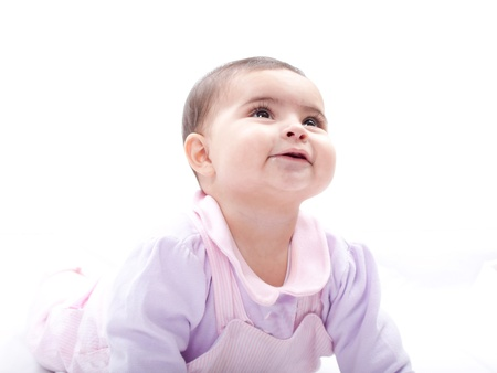 Close up of smiling baby crawling on floor  Stock Photo - 13905515