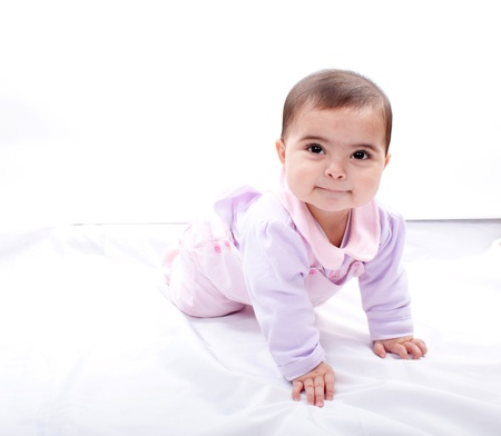 Close up of smiling baby crawling on floor  Stock Photo - 13905518