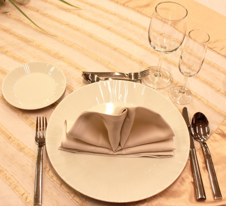 Tables set for fine dining during a wedding event. photo