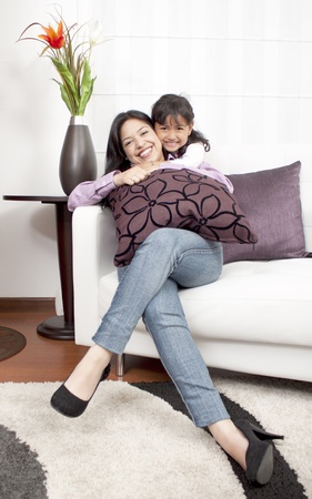 mother and girl smiling in the room  photo