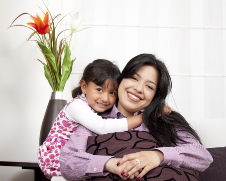 Mother and girl smiling in the living room Stock Photo - 14902651