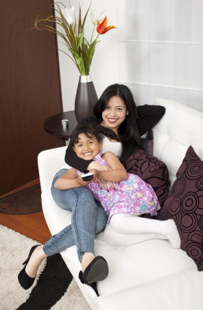 mother and girl smiling in the home  photo