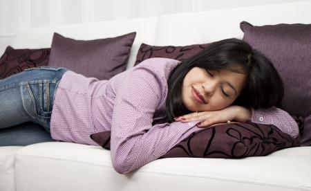 Young girl, woman sleeping on a sofa Stock Photo - 14902667