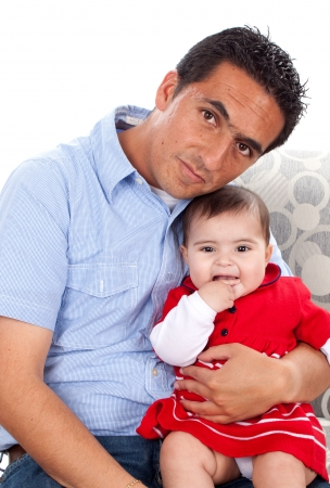 Portrait of sweet young baby with her father at home  photo
