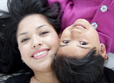 Beautiful mother and daugther over white Stock Photo - 23256154