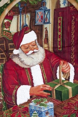 nick: Santa next to a Christmas tree giving a gift Stock Photo