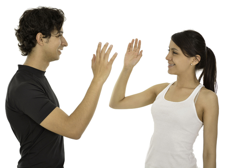 five: This couple hi five and smile they have a sport clothes.