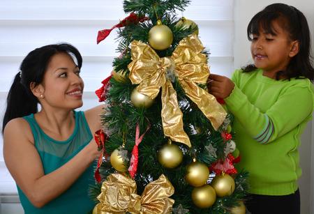 decorating christmas tree: Young family decorating a Christmas tree
