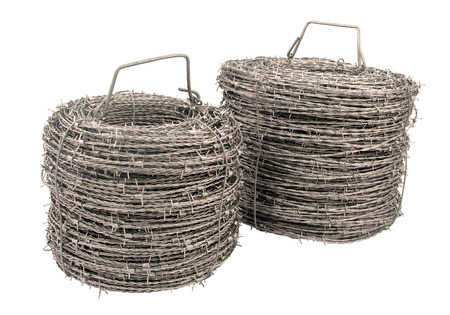 barbed wire fence: A roll of barbed wire on white background.