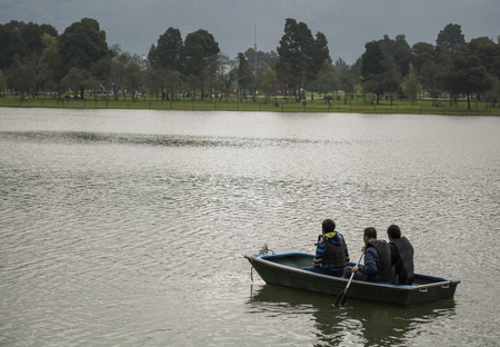 Family of three canoing on a calm river. photo