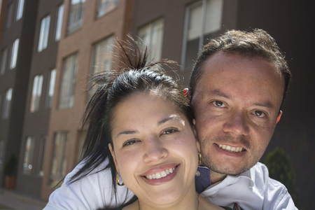 Attractive, very happy young couple embracing and smiling. photo