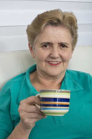 Senior Woman Enjoying Cup Of Tea At Home.