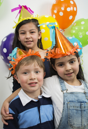 Group of adorable kids having fun at birthday party. photo