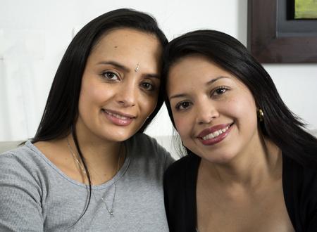 Closeup portrait of two happy women embracing. photo