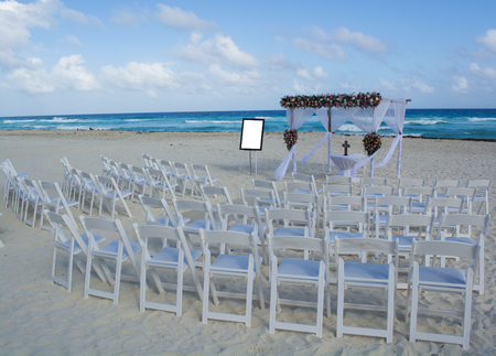 Decorated wedding table on the beach.