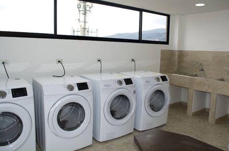 Plenty of washing machines in a laundry. Stockfoto