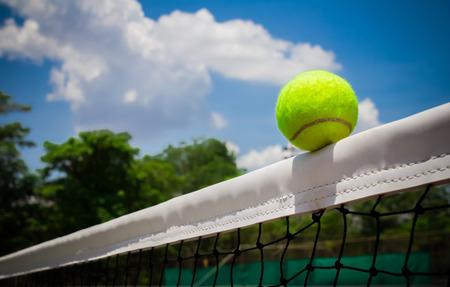 Tennis ball hitting the net