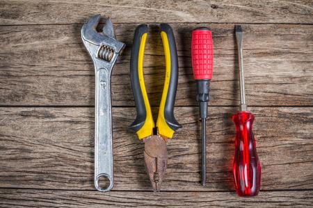 wood panel: Set of tools on wood panel Stock Photo