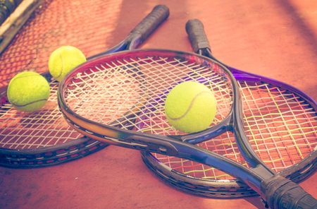 avocation: Tennis racket with balls on tennis court,vintage color