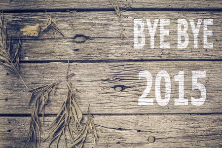 bye: Bye Bye 2015 on old wood background