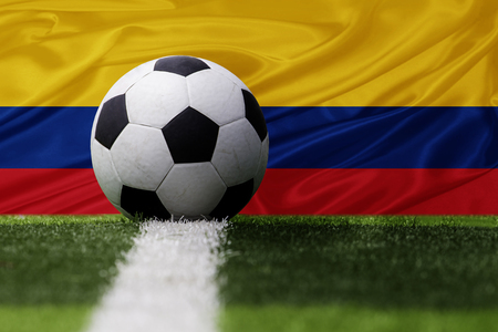 Colombia soccer ball and Colombia flag Standard-Bild