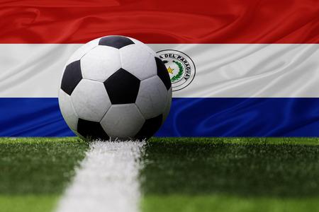 bandera de paraguay: Paraguay bal�n de f�tbol y la bandera de Paraguay Foto de archivo