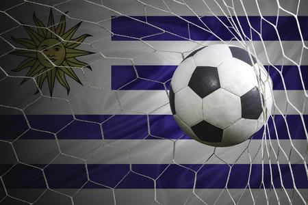 bandera de uruguay: bandera de Uruguay y bal�n de f�tbol, ??f�tbol en red de la porter�a