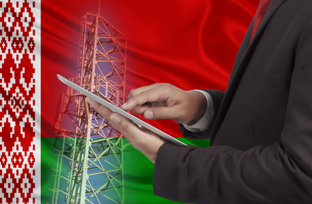 hands free phone: business and mobility communications concept BelarusFlag background Stock Photo