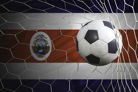 bandera de costa rica: bandera de Costa Rica y el balón de fútbol, ??fútbol en red de la portería Foto de archivo