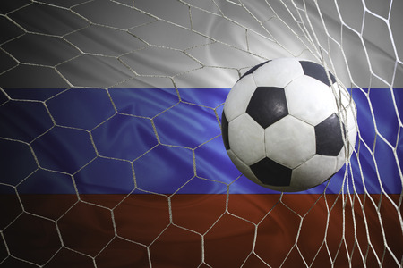 multi national: Russia flag and soccer ball, football in goal net