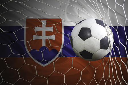 slovakia flag: Slovakia flag and soccer ball, football in goal net Stock Photo