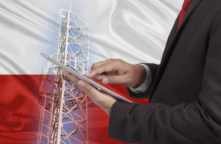 hands free device: business and mobility communications concept Poland Flag background Stock Photo